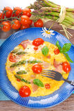 Frittata with green asparagus,ham and cherry tomato Stock Photos