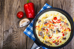 Frittata with mushrooms and peppers in frying pan Stock Images