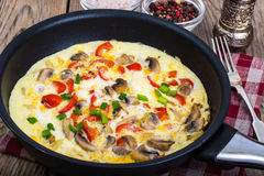 Frittata with mushrooms and peppers in frying pan Royalty Free Stock Image