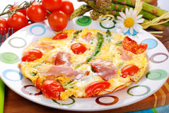 Frittata omelet with asparagus,tomato and ham Stock Photo