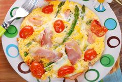 Frittata omelet with asparagus,tomato and ham Stock Photos