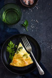 Frittata (omelette) with vegetables and cheese in cast iron pan Stock Photo