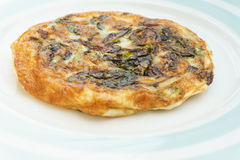 Frittata with onions and cheese. Homemade Frittata with onions, vegetable and parmesan cheese royalty free stock photo