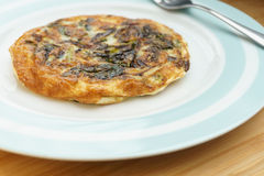 Frittata with onions and cheese. (3/4 view). Homemade Frittata with onions, vegetable and parmesan cheese royalty free stock image