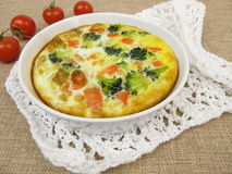 Frittata with rice, carrots, broccoli and tomatoes Royalty Free Stock Photo