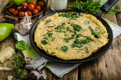 Frittata with spinach and garlic Stock Photos