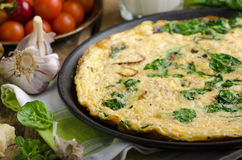 Frittata with spinach and garlic Stock Photography