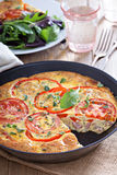 Frittata with vegetables and ham Stock Images