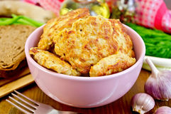Fritters chicken in a pink bowl on the board Royalty Free Stock Images