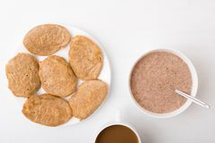 Fritters, coffee and flax-seed porridge on white Royalty Free Stock Photos
