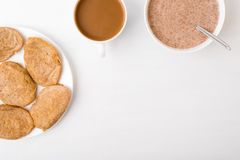 Fritters, coffee and flax-seed porridge on white Royalty Free Stock Image