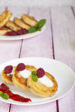 Fritters of cottage cheese with berries Stock Photo