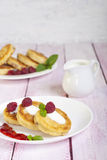Fritters of cottage cheese with berries Royalty Free Stock Photography