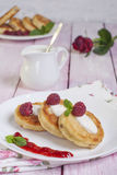 Fritters of cottage cheese with berries Stock Images