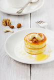 Fritters of cottage cheese with honey and nuts. On a white plate Stock Photography