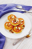Fritters of cottage cheese with honey and nuts Royalty Free Stock Photography