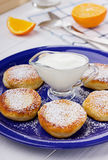 Fritters of cottage cheese with sour cream. On a white background Royalty Free Stock Photo