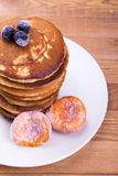 Fritters with frozen fruit. Freshly prepared punkcakes. Delicious breakfast with fruits Royalty Free Stock Photos