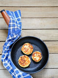 Fritters in a frying pan Stock Photo