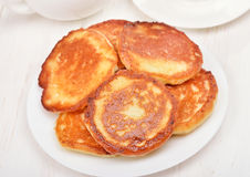 Fritters with honey on white plate Stock Photography