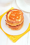 Fritters with honey on white plate Stock Photo