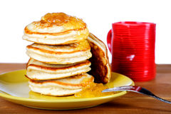Fritters with jam and a cup on white Stock Image