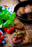 Fritters from a liver with tomato sauce Stock Images