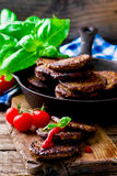 Fritters from a liver with tomato sauce Stock Photography