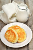 Fritters and milk jug Royalty Free Stock Photos