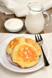 Fritters, milk jug and sour cream Royalty Free Stock Photo