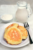 Fritters, milk jug and sour cream Royalty Free Stock Photos