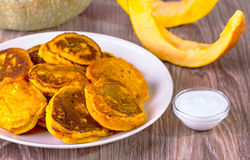Fritters with pumpkin on a beige plate Royalty Free Stock Images