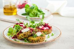 Fritters with quinoa. Vegetables and flax seeds Stock Photos
