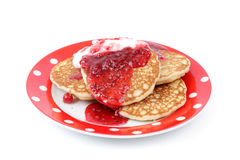 Fritters with raspberry jam on a plate Royalty Free Stock Photos