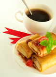 Fritters with ribbon and a cup of coffee Stock Photos