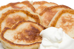 Fritters with sour cream Stock Images