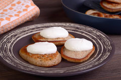 Fritters with sour cream Stock Image