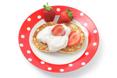 Fritters with sour cream and a strawberry Stock Image