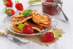 Fritters with strawberry jam Royalty Free Stock Image