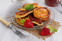 Fritters with strawberry jam Royalty Free Stock Photos