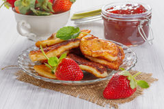 Fritters with strawberry jam Royalty Free Stock Photo