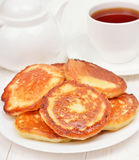 Fritters and tea Royalty Free Stock Photography