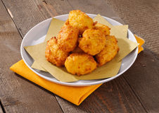 Fritters on yellow paper stock photo