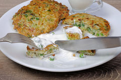 Fritters of zucchini and peas Royalty Free Stock Photo