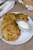 Fritters of zucchini and peas Stock Photos