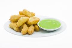 Frittiertes doughstick def und Schraubenpalme Stockfotos
