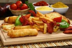 Fritto ed alimento di ingrassamento Fotografia Stock