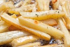 Frittura delle patate fritte Immagine Stock