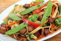 Frittura di scalpore della tagliatella del tofu Fotografia Stock
