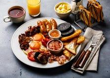 Frittura piena sulla prima colazione inglese con le uova fritte, salsiccie, bacon immagini stock libere da diritti